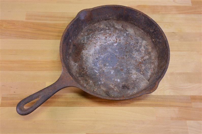 how to fix rusted cast iron pan