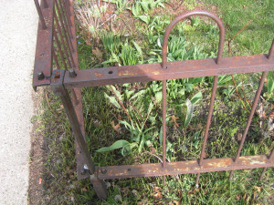 Photo showing Rusty Wrought Iron Fence