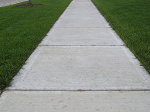 The sidewalk is free of rust stains after using Concrete Rust Remover